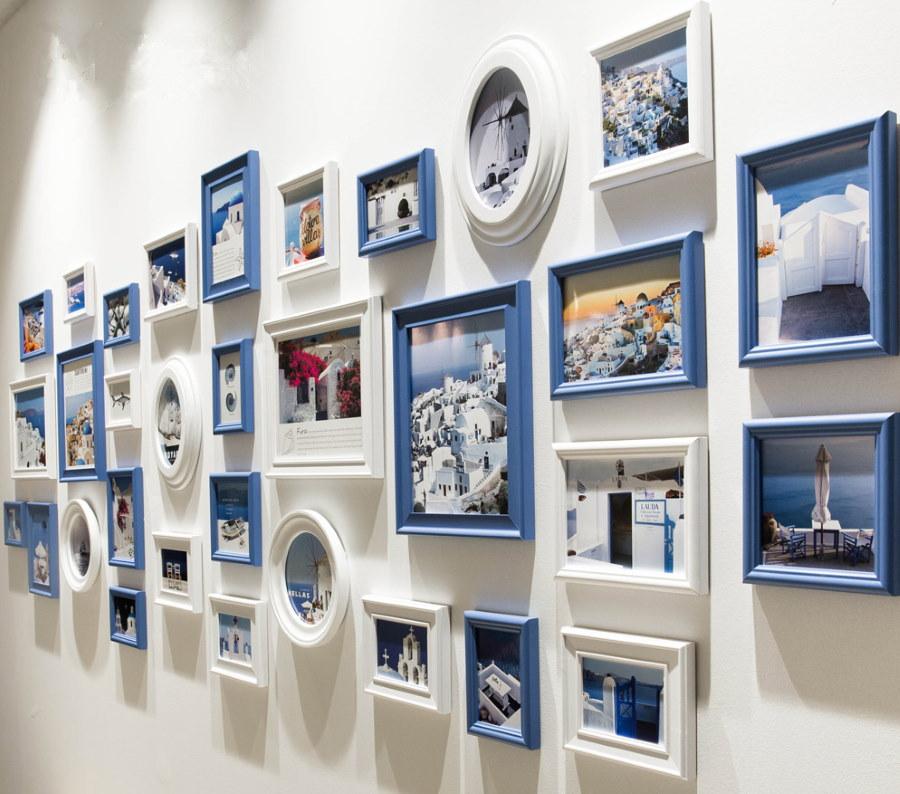 Подсветка фотографий на стене спальной комнаты
