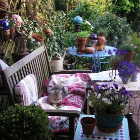 современная садовая скамейка фото