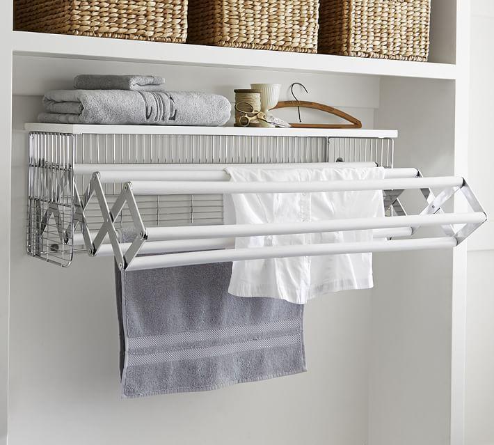 Выдвижная сушилка для вещей в прачечной комнате