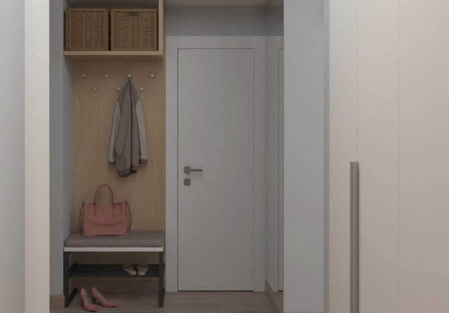 Тумба с вешалкой в прихожей комнате