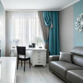 Серый диван раскладного типа