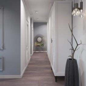 Серая стена в конце длинного коридора