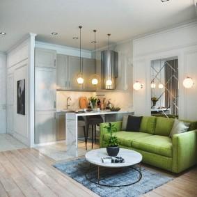Зеленый диван раскладного типа