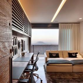 Кровать-диван в спальне с большим окном