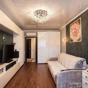 Корпусная стенка в гостиной прямоугольной формы