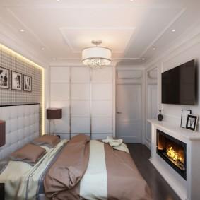 Неоклассический интерьер спальни с камином