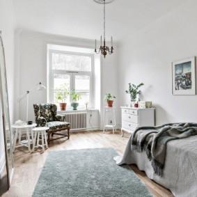 Комод в интерьере спальни скандинавского стиля