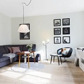Красивая комната с диваном углового типа