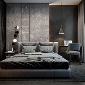 Серая кровать на полу в спальне