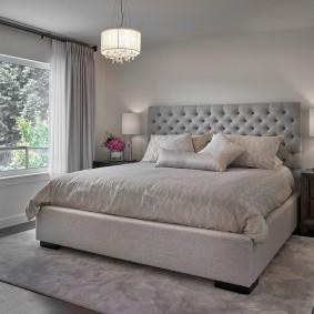 Кровать супругов на сером основании