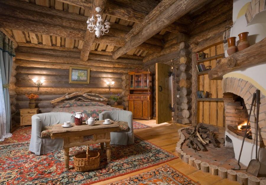 Камин в интерьере спальни в стиле кантри