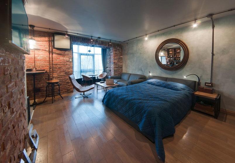 Кровать в гостиной индустриального стиля