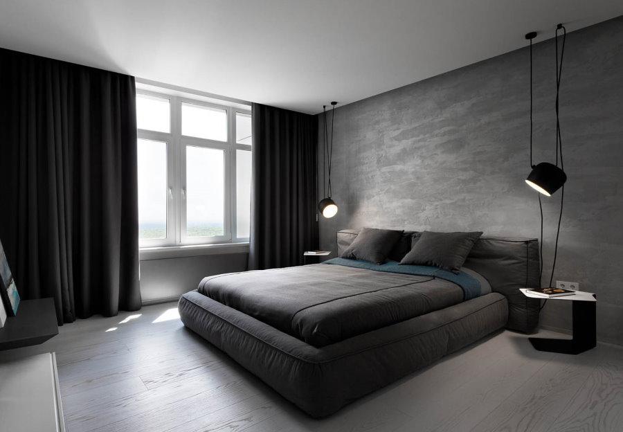 Интерьер серо-черной комнаты для холостяка
