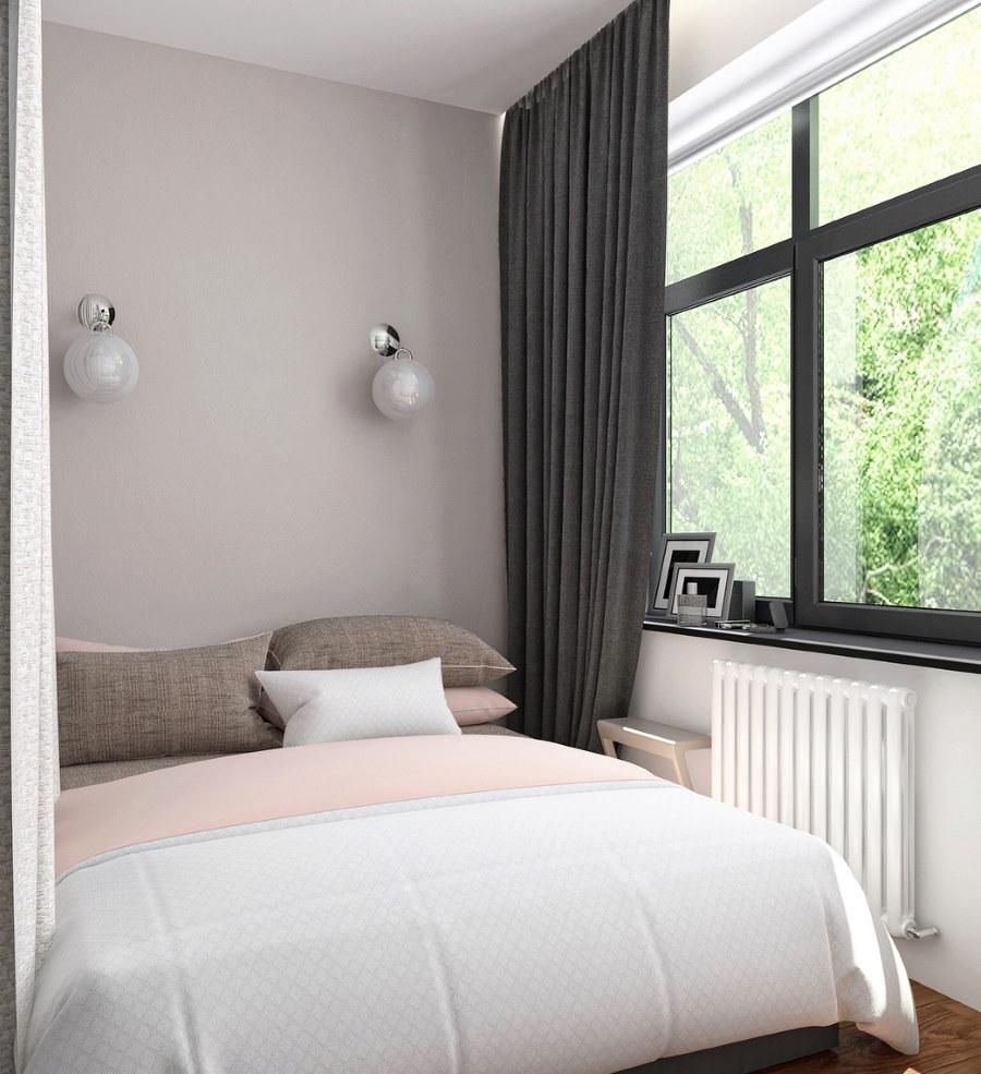 Плотная штора серого цвета в небольшой спальне