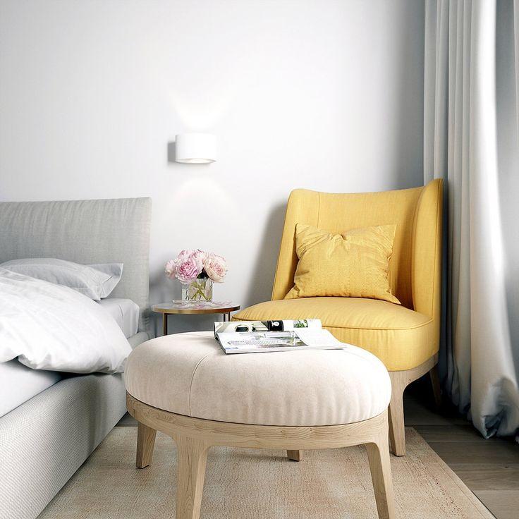 Желтое кресло около серой кровати