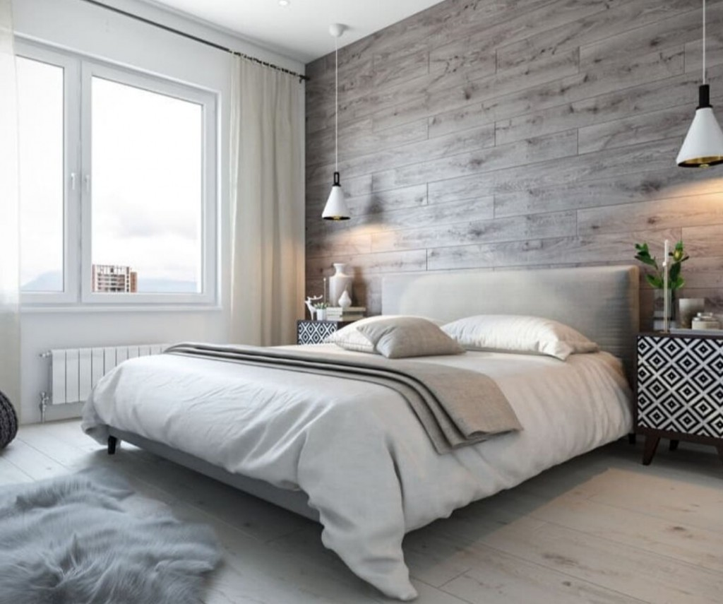 Деревянные панели серого цвета над кроватью в спальне