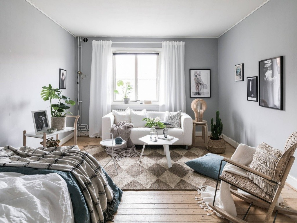 Интерьер гостиной с кроватью в стиле сканди