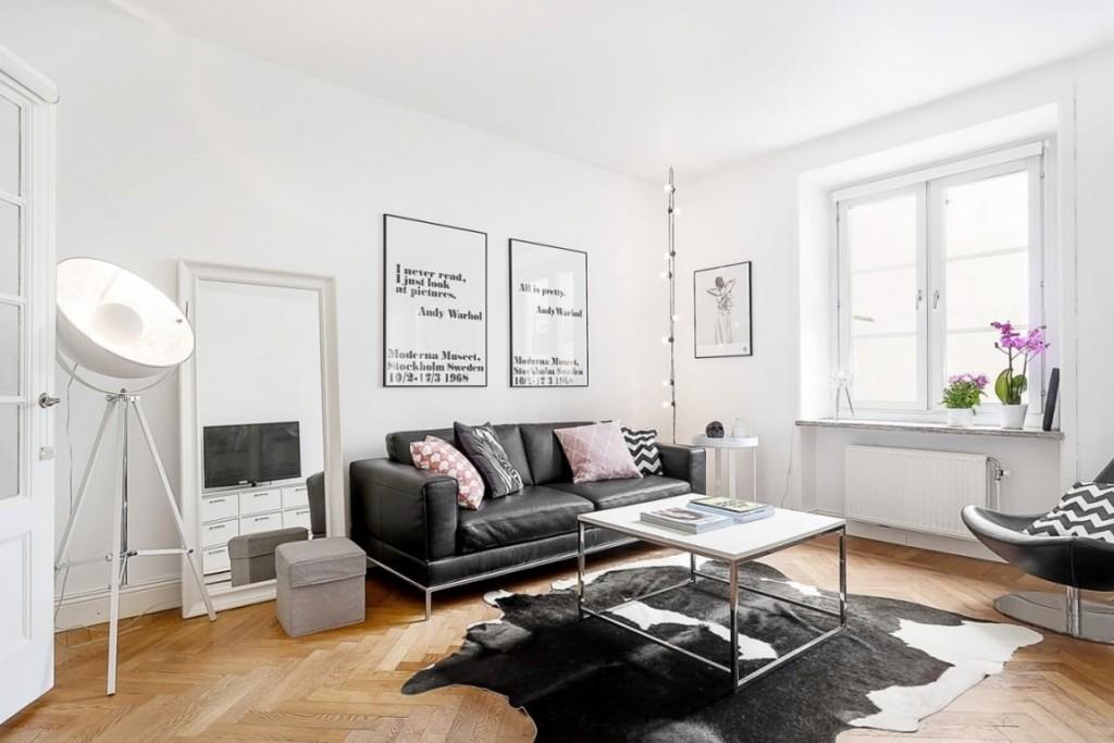 Интерьер гостиной комнаты в стиле сканди