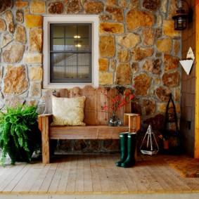 Отделка наружной стены дома природным камнем