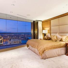 Интерьер спальной комнаты с панорамным окном