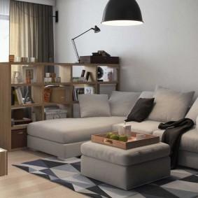 Серый угловой диван в комплекте с пуфом