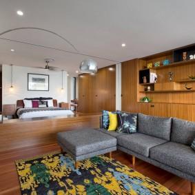 Серый диван углового типа