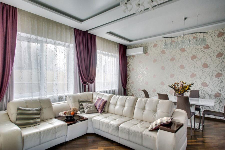 Зонирование диваном гостиной-столовой