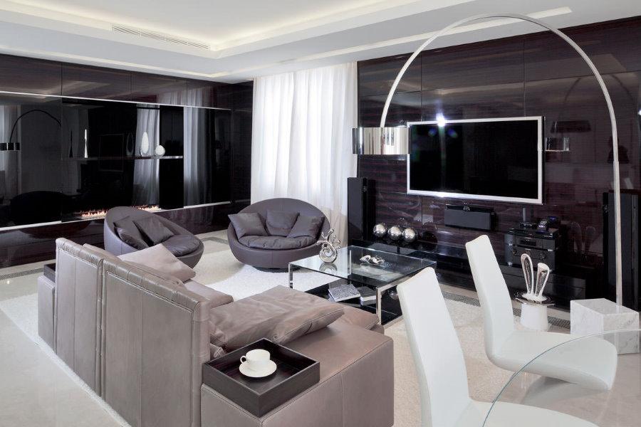 Черная мебель с глянцем в зале стиля хай-тек