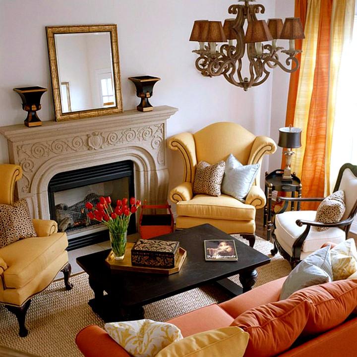 Каминное кресло в интерьере гостиной