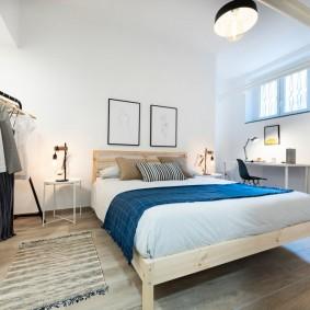 кровать в спальне скандинавский стиль