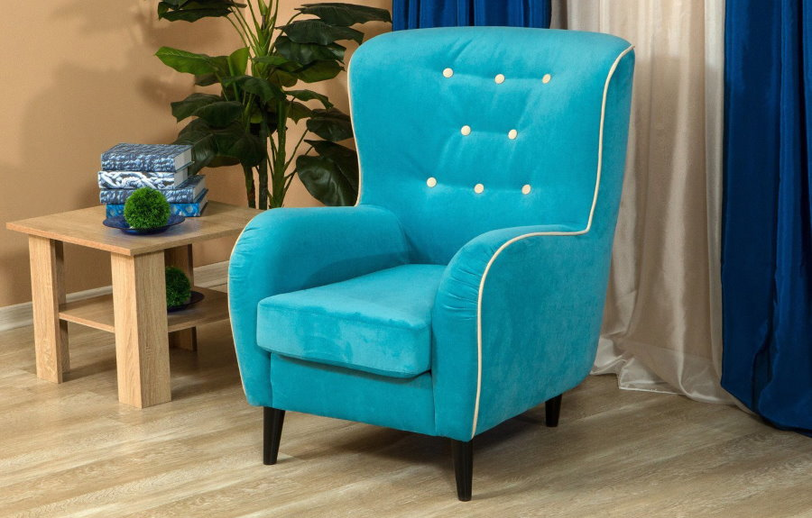 Маленькое кресло с тканевой обивкой бирюзового тона