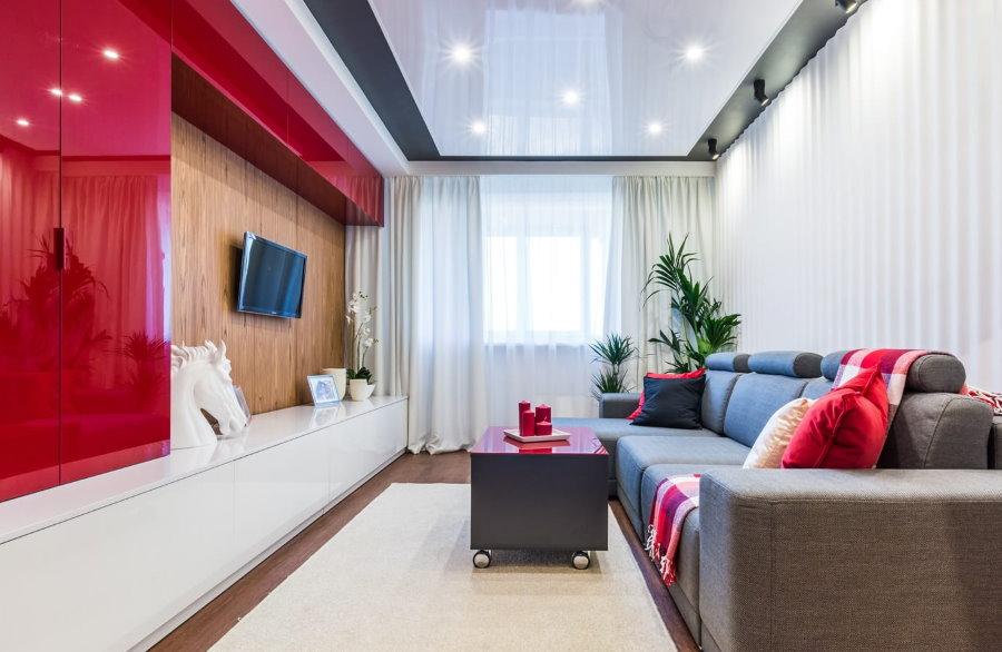 Красно-белая стенка в зале небольшой квартиры