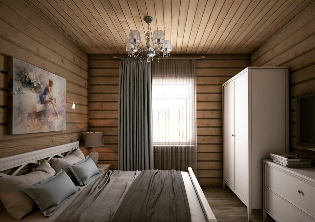 Небольшая спальня с кроватью и шкафом