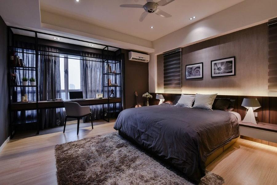 Большая спальня с рабочим местом у окна комнаты