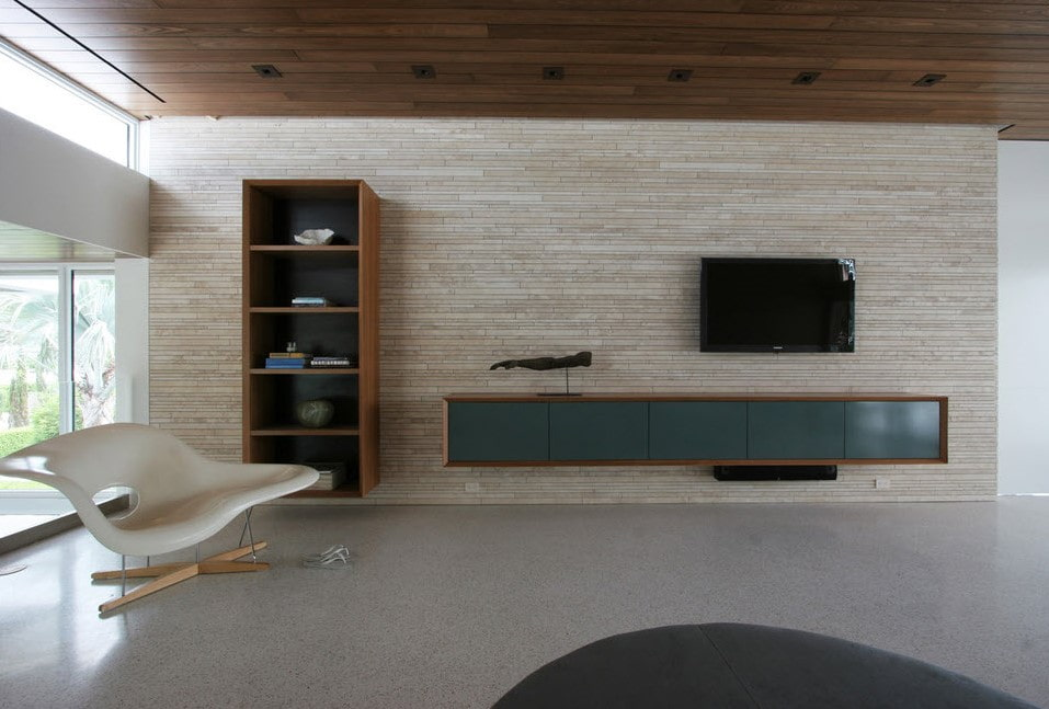 Оформление стены с телевизором в гостиной стиля минимализма