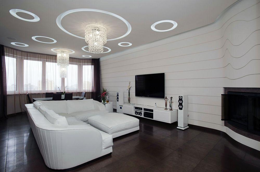 Сочетание темного пола с белыми стенами в зале