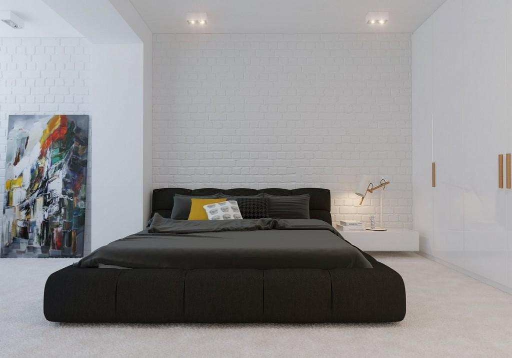 Черная кровать в белой спальне