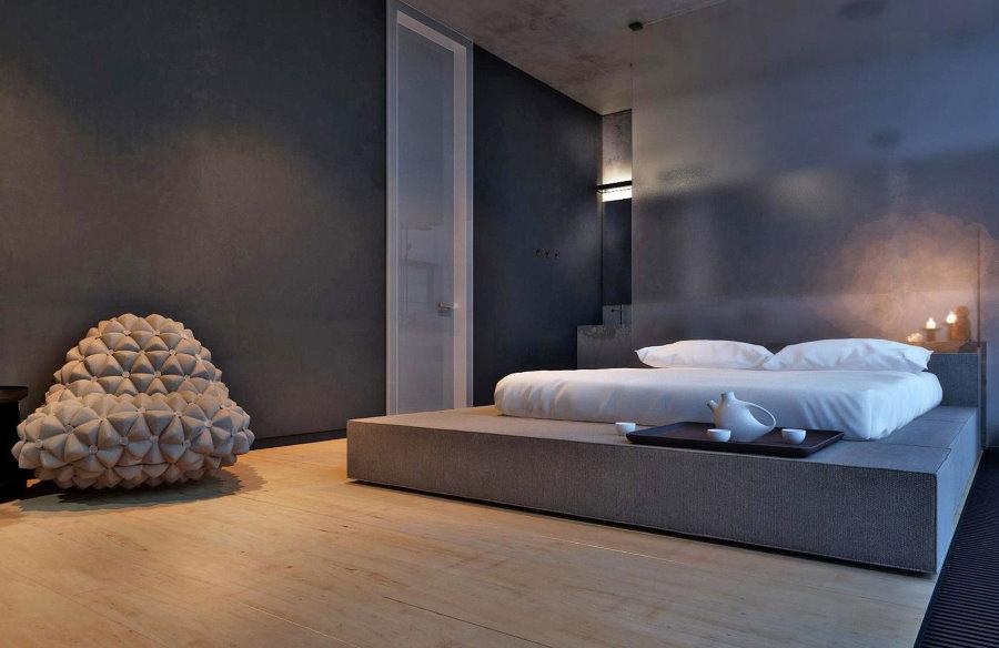 Белый матрас на бетонном подиуме серого цвета