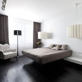 Интерьер спальни с полом темного оттенка