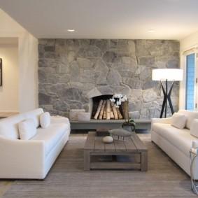 Акцентная стена гостиной из серого камня