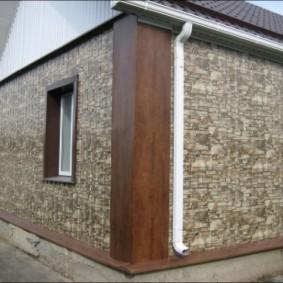 Обшивка фасада панелями под природный камень