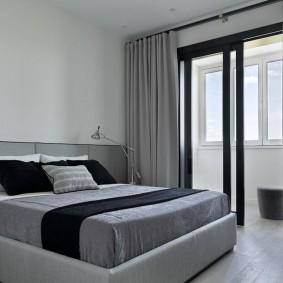 Спальня в стиле минимализма с серыми шторами