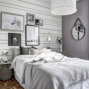 Красивая спальня с фотографиями на стене