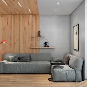 Зонирование вагонкой гостиной с серым диваном
