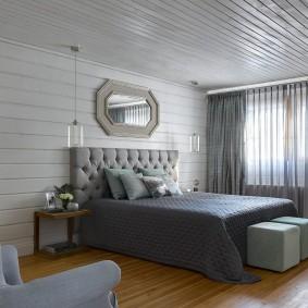 Серые занавески в интерьере спальни