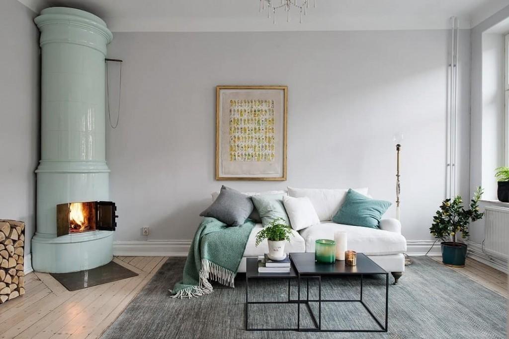 Угловой камин в интерьере гостиной в стиле сканди