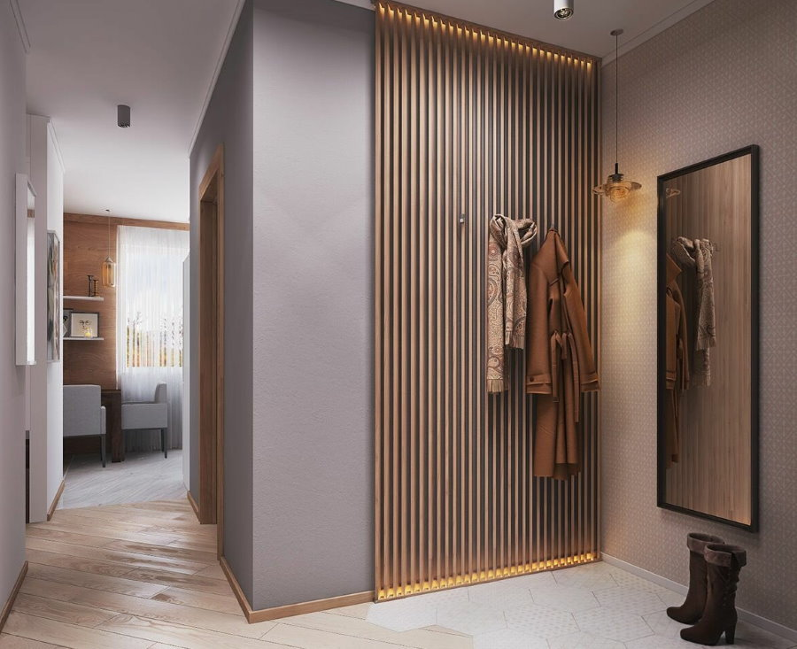 Деревянные рейки на стене прихожей с вешалкой