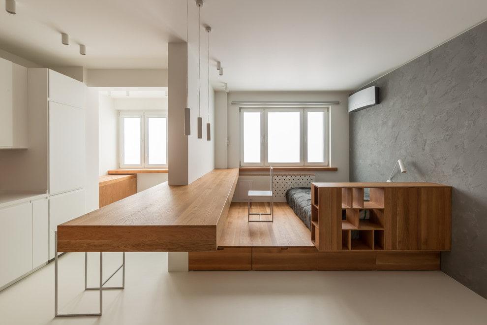 Подиум в интерьере квартиры студийной планировки
