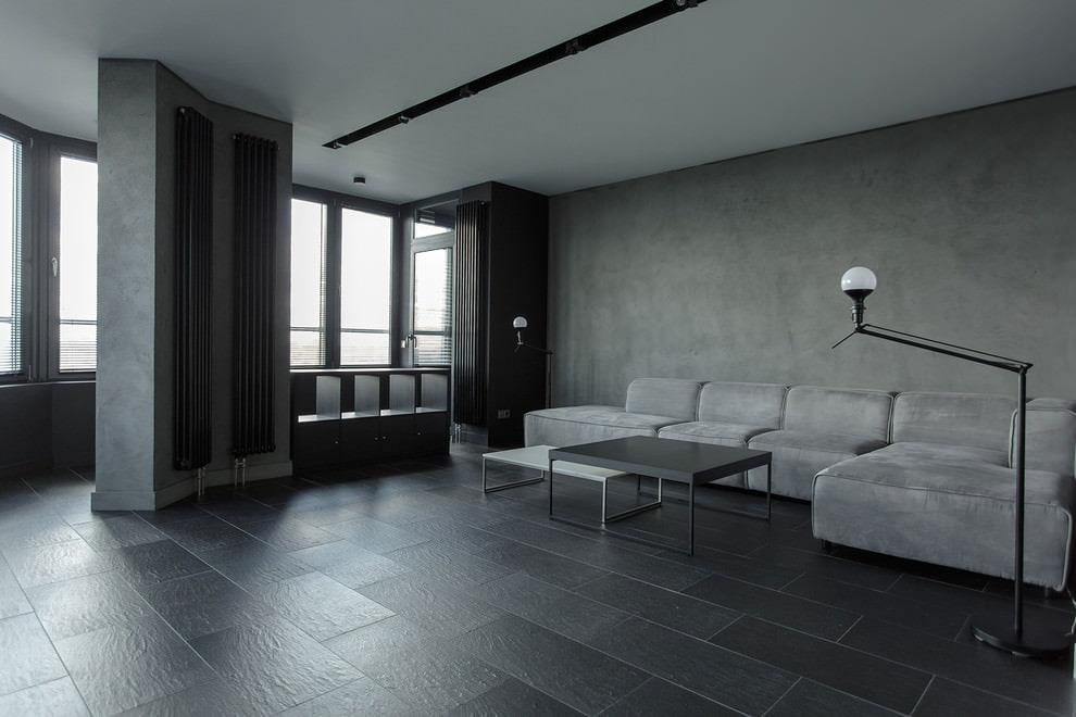 Керамический пол темного цвета в квартире-студии