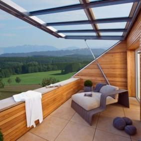 Подъемные окна на балконе в мансарде